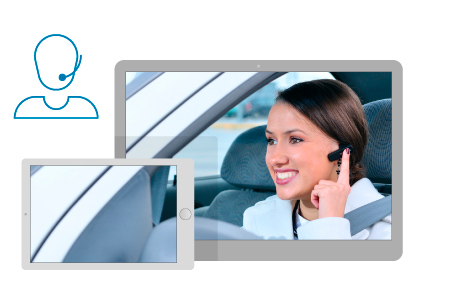 Tablet screen with a picture of a smiling travel agent booking business hotel from her car