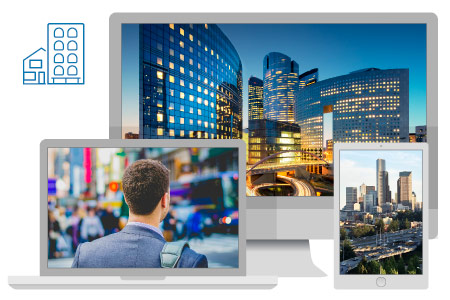 Three pictures displayed in the screens of a laptop, desktop computer and mobile phone. The first one has a business man walking downtown, and the other two are landscapes of modern cities