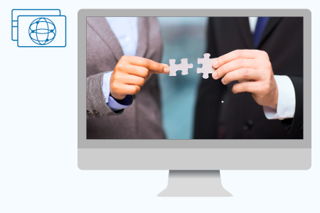 Picture dispalyed on a desktop computer of the hands of two managers joining two pieces of a puzzle