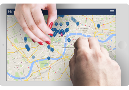 Hands of two people searching on a tablet for business hotels in Hotelzon's map view