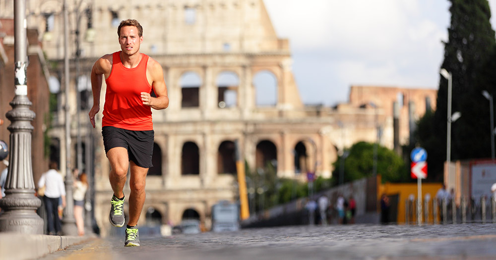 Business traveler running in Rome